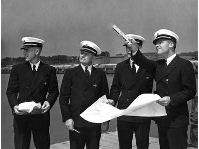 Pan Am Capt. R.O.D. Sullivan, 2nd frm left,