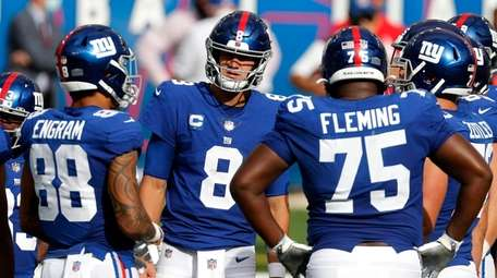 Daniel Jones of the Giants looks on with