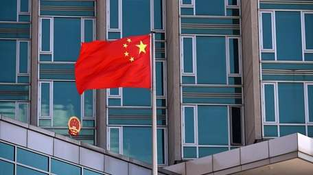 A Chinese flag flies at the Consulate General