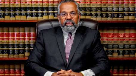 Attorney Fred Brewington in his office in Hempstead.