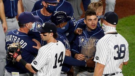 Tyler Wade and Erik Kratz of the Yankees