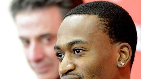 Louisville forward Kevin Ware answers questions as coach
