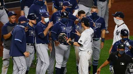 Members of the Yankees and the Rays exchange