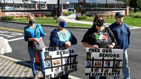 People rally outside the Long Island State Veteran