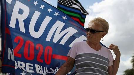 A Trump supporter awaits the president's arrival at