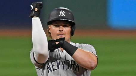 The Yankees' Luke Voit celebrates after hitting a