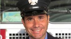 Roger Espinal, a member of the FDNY Bureau