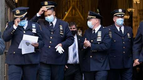 NYPD department members exit St. PatrickÕs Cathedral Monday,