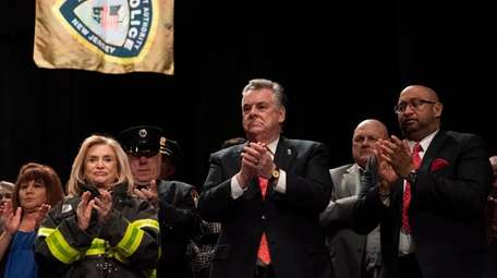 U.S. Rep. Pete King, center, attends a ceremony