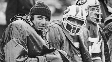 Joe Namath sits on the sidelines during the