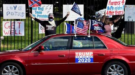 Supporters of President Donald Trump gather outside Walter