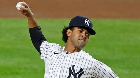 Yankees pitcher Deivi Garcia winds up during the