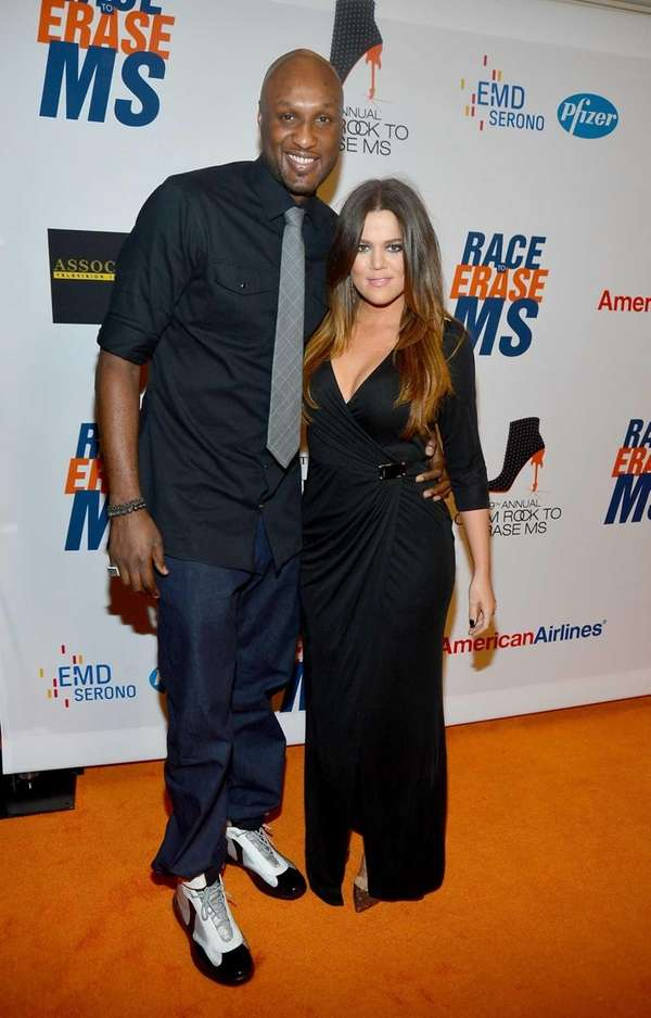 Lamar Odom and TV personality Khloe Kardashian arrive