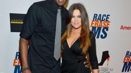 Lamar Odom and TV personality Khloe Kardashian arrive