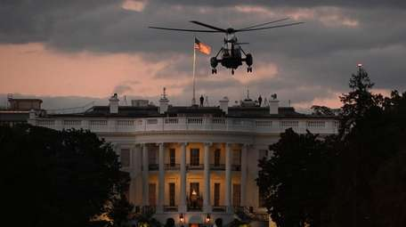 Marine One flies over the White House on