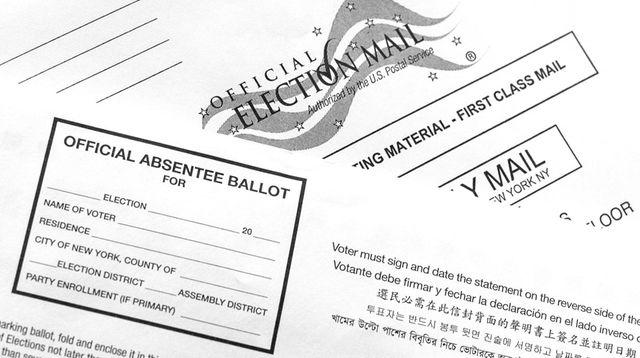 An official absentee ballot is shown on a
