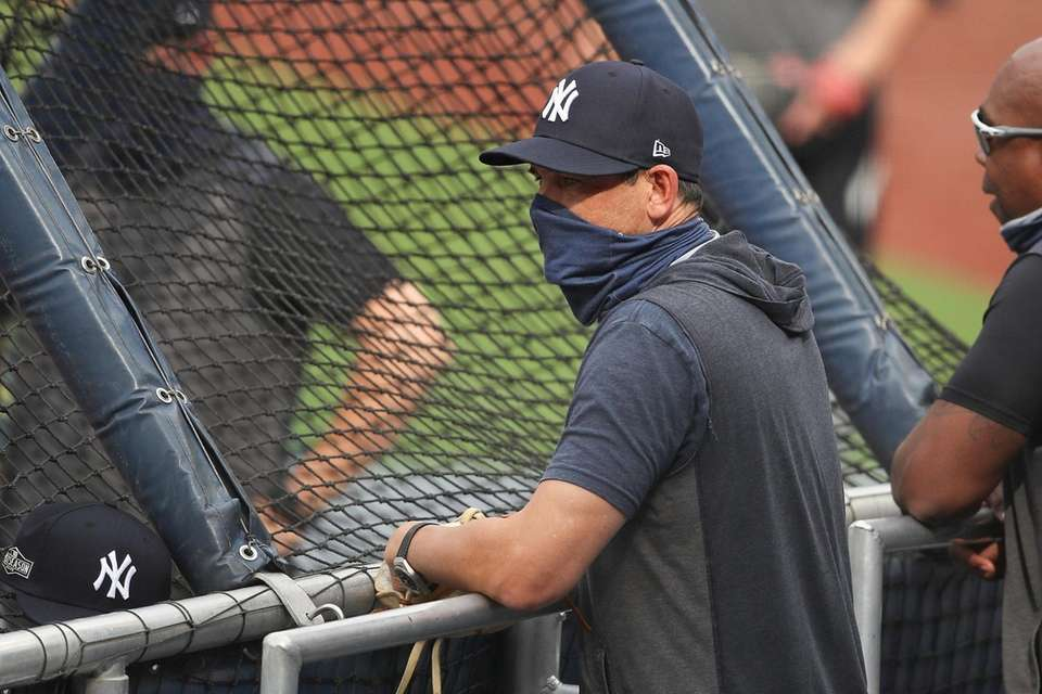 Yankees manager Aaron Boone looks on during batting