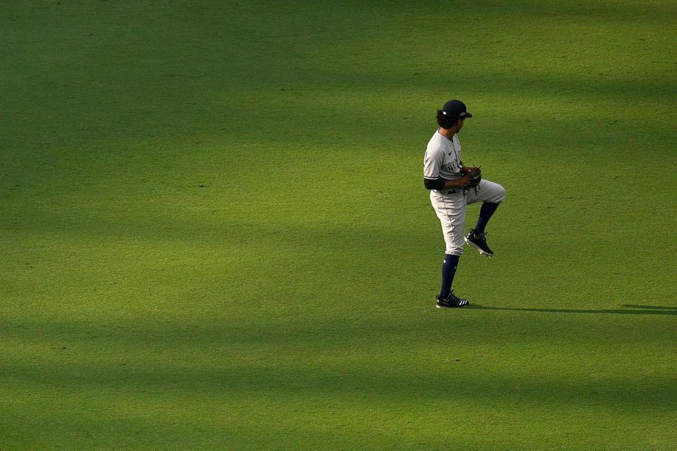 New York Yankees starting pitcher Deivi Garcia warms