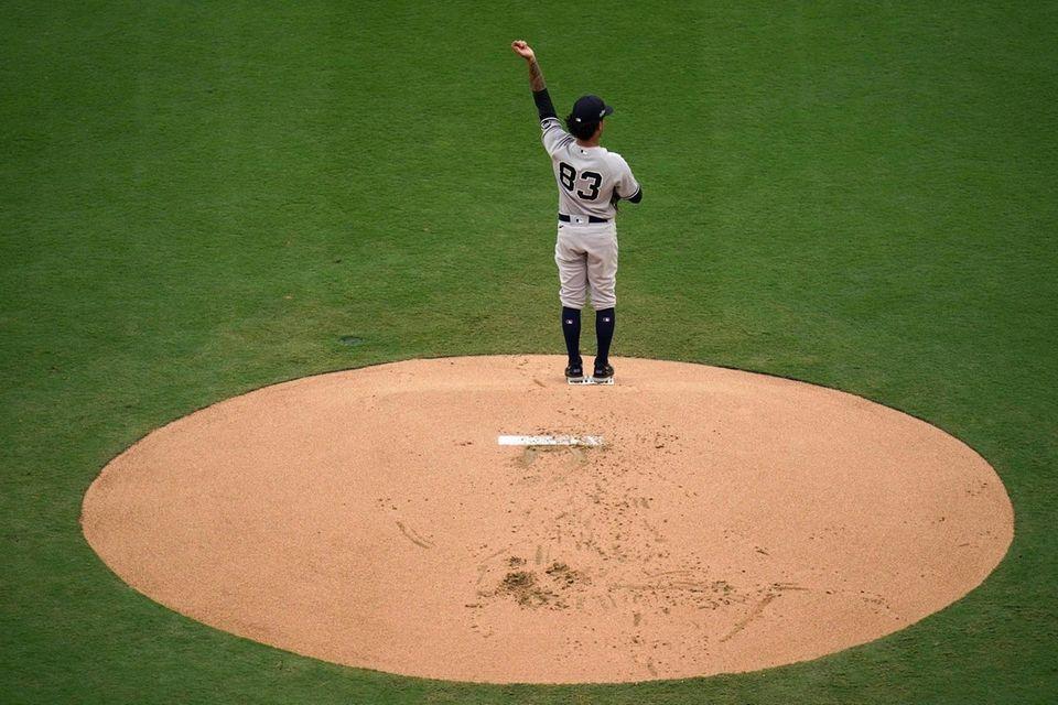 New York Yankees starting pitcher Deivi Garcia stretches