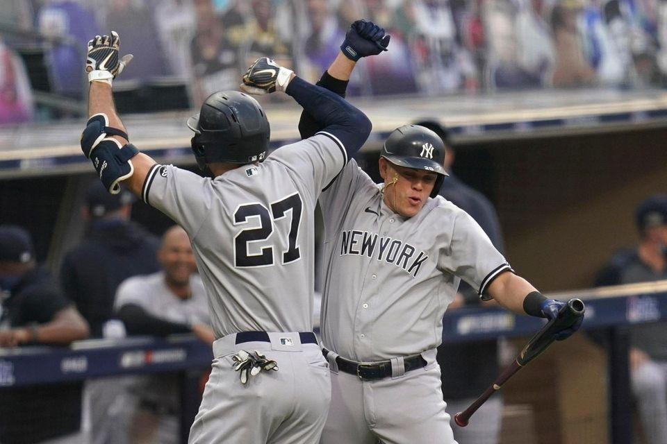 New York Yankees' Giancarlo Stanton (27) celebrates with