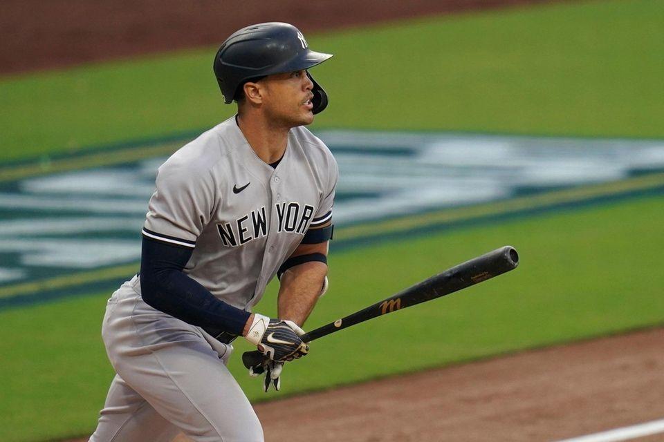 New York Yankees' Giancarlo Stanton watches his solo