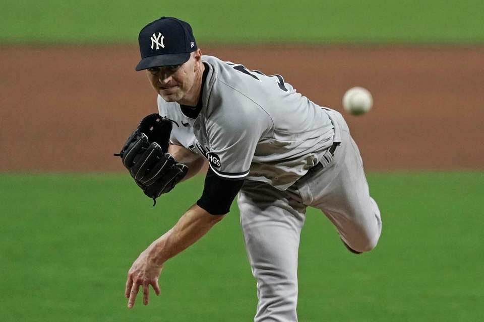 Yankees pitcher J.A. Happ throws against the Rays