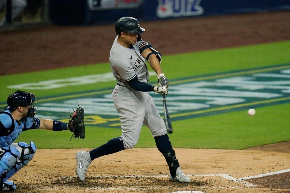New York Yankees' Giancarlo Stanton hits a three-run