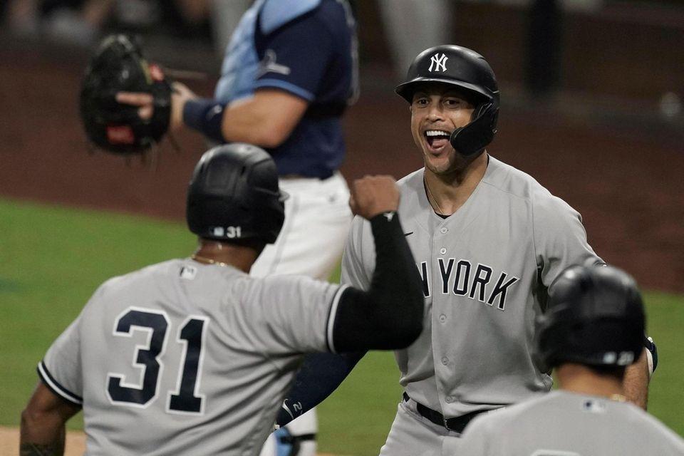 New York Yankees' Giancarlo Stanton, right, celebrates with