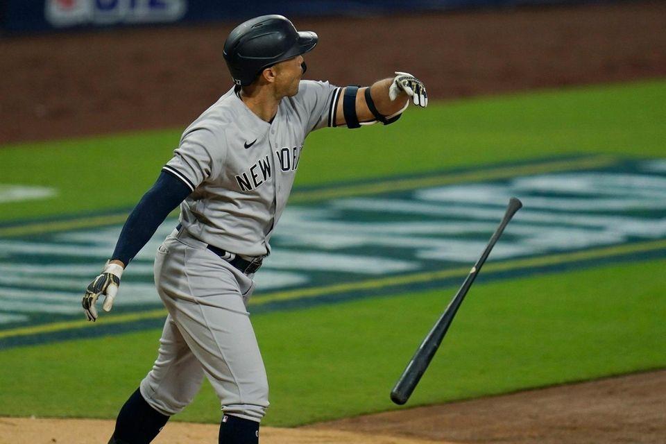 New York Yankees' Giancarlo Stanton tosses his bat