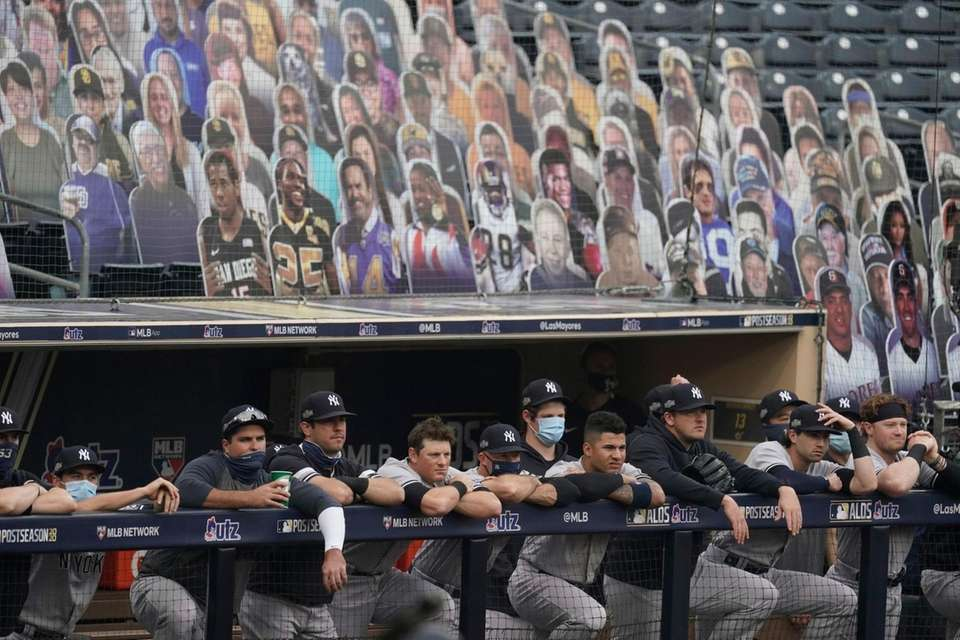 New York Yankees stand at the dugout rail
