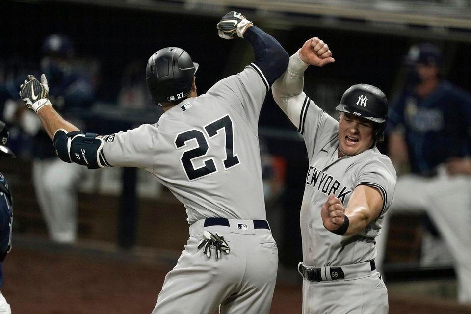 New York Yankees' Giancarlo Stanton (27), celebrates with