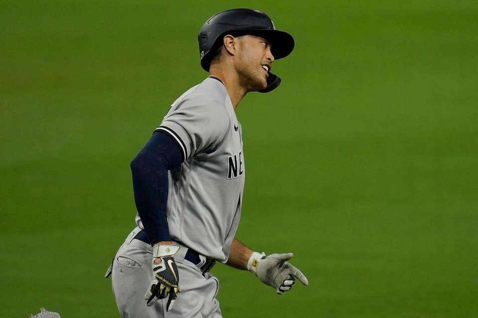 New York Yankees' Giancarlo Stanton rounds the bases