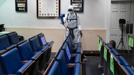 A member of the White House staff sprays