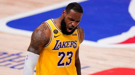 Lakers forward LeBron James celebrates during the second