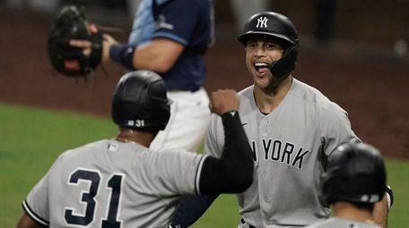 The Yankees' Giancarlo Stanton, right, celebrates with Aaron