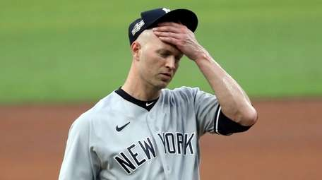 J.A. Happ of the Yankees reacts after allowing