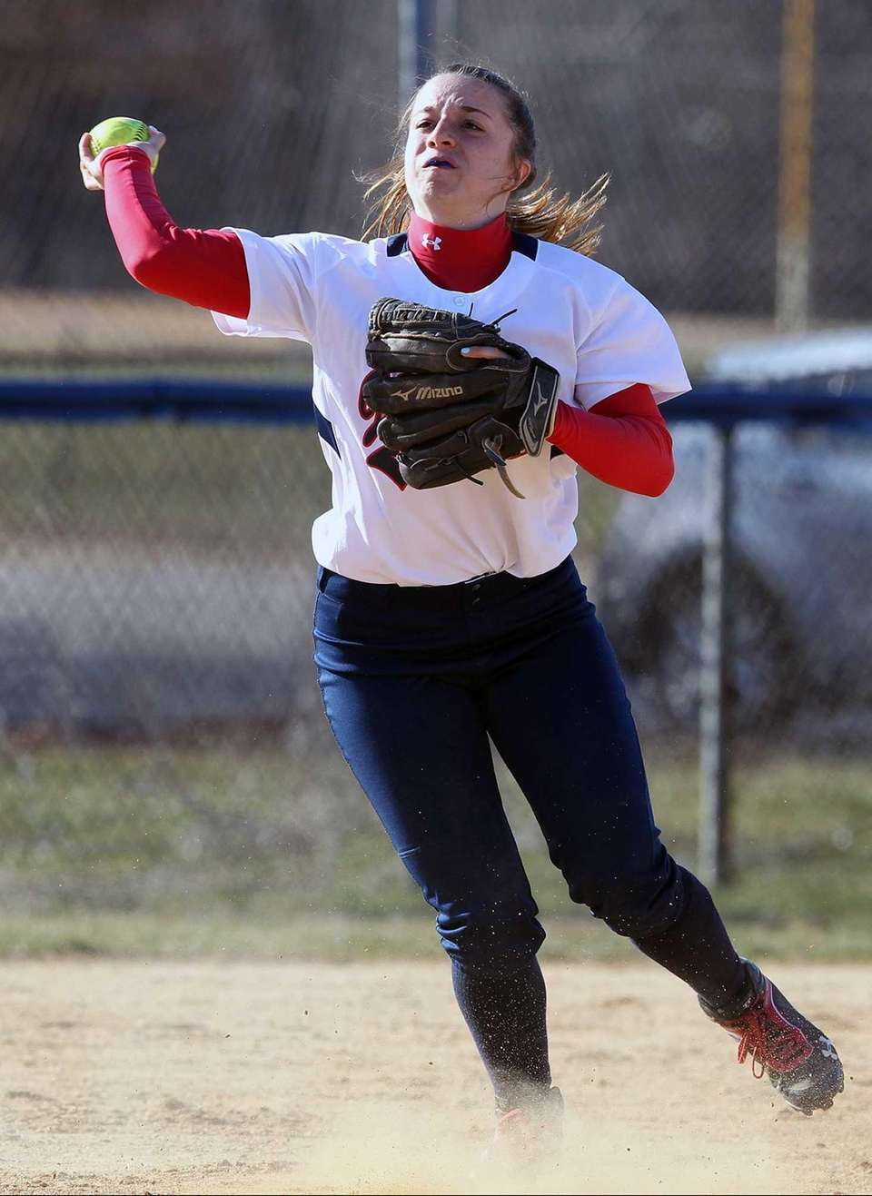 MacArthur's Kristin Daly throws from third against MacArthur.