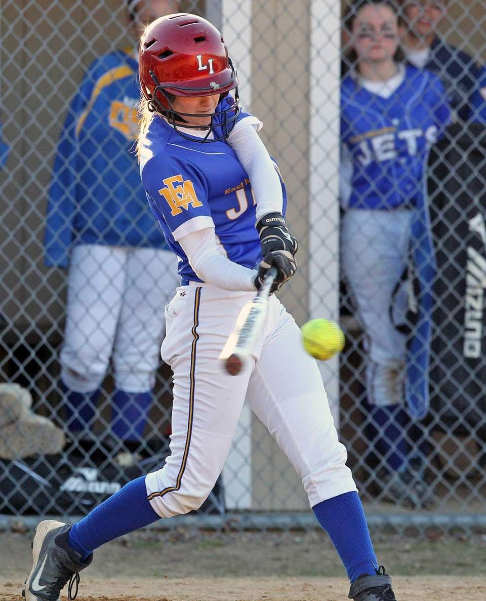 East Meadow's Danielle Cutuli makes contact against MacArthur.