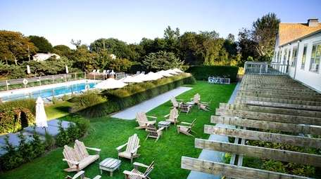 The pool and outdoor lounge area of the