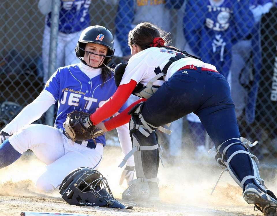 East Meadow's Claire Travis slides in safe under