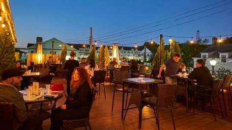 Patrons enjoy outdoor dining on Roslyn Social's heated