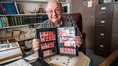 Steve Reinhard, seen with some of the stamps