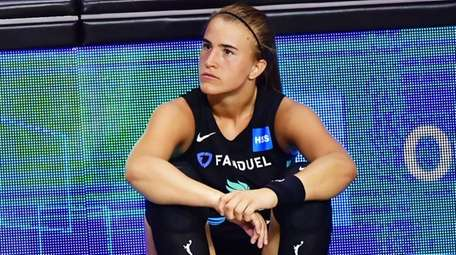 Sabrina Ionescu of the Liberty looks on from
