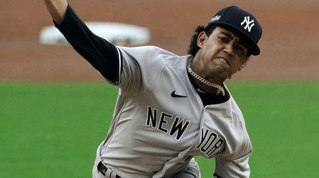 Yankees starting pitcher Deivi Garcia throws against the