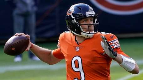 Bears quarterback Nick Foles throws during the first