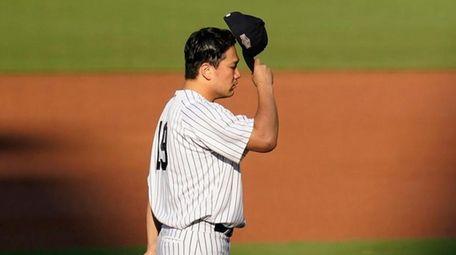 Yankees starting pitcher Masahiro Tanaka prepares during the