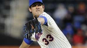 Matt Harvey delivers a pitch in the first