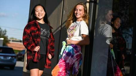 Anna Limb, wearing a flannel, left, and Carys