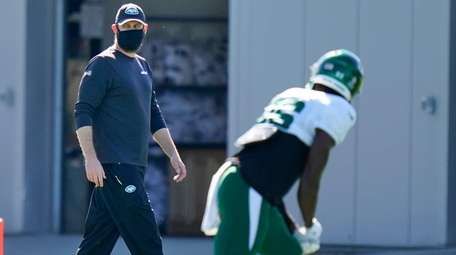 Jets head coach Adam Gase looks over his