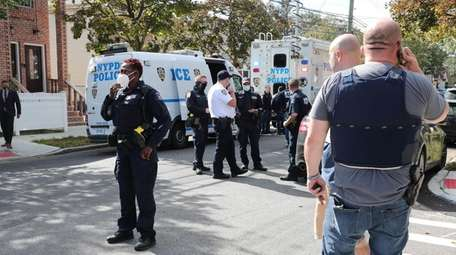 NYPD investigators at the scene in Queens Thursday